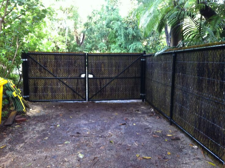 """The reverse view from my previous pin showing the behind the scenes view of this particular fence job Previous pin: """"Western Australian brushwood panels installed! Attached to """"top rail"""" chain link fencing, the brushwood (50mm) screening has that unique and natural look and also has the added strength and durability of top and bottom rail, black plastic coated, chain link fencing supporting it."""""""