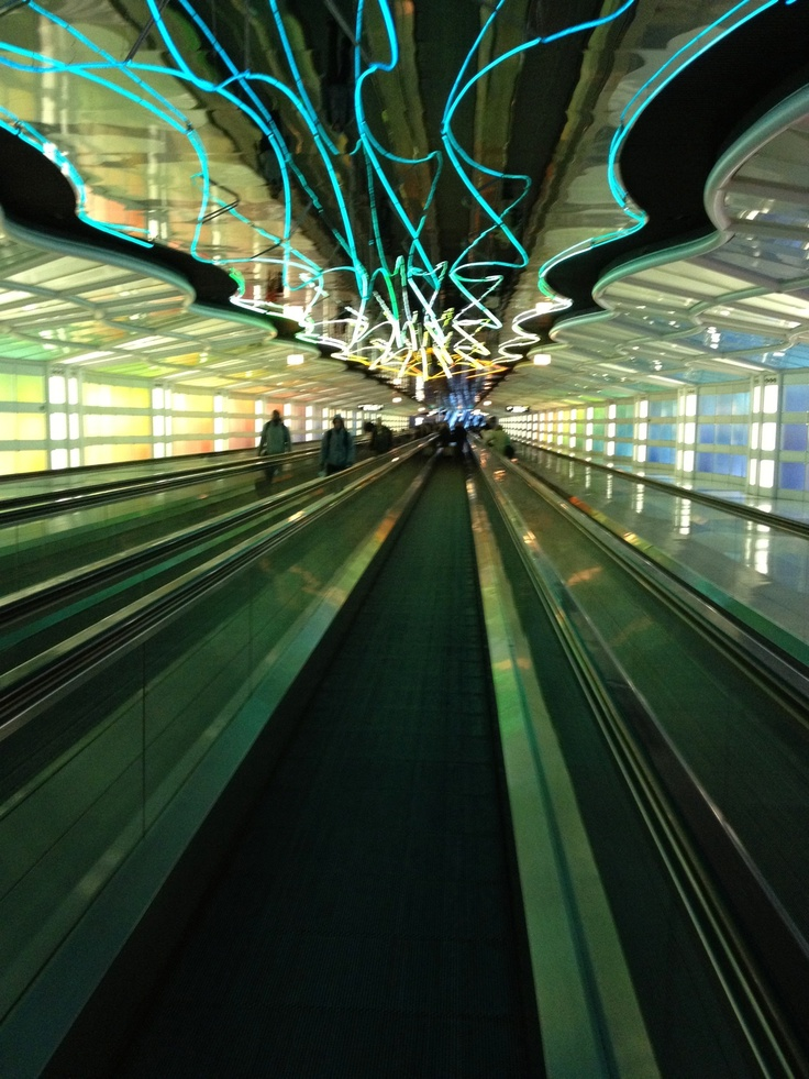 Chicago O'hare Airport, the colors of the lights change on the moving walkway and the eerie music calms you down before a flight...