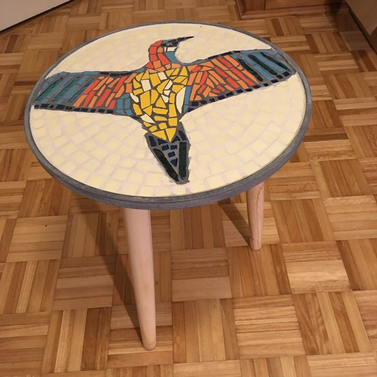 Mosaic tabletop with bee-eater