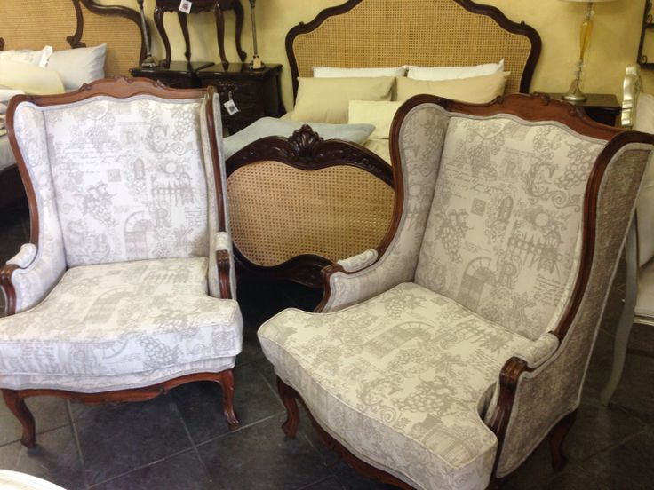 Wingback chairs covered in soft grey fabric