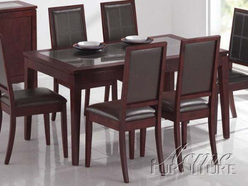 Albury 5-Pc Dining Table Set by Acme by Acme Furniture. $634.99. Albury 5-Pc Dining Set by Acme The Albury Collection is perfectly transitional with its contemporary style and classic lines just right for any dining room. Crafted from solid hardwoods and veneers in a dark finish with dining chairs upholstered in a beautiful easy care bycast leather. Creates a dining room sure to delight the entire crowd for everyday dining or special occasions. The table has a glass table...
