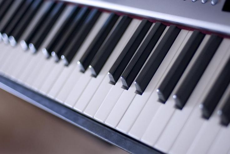 keys on a piano keyboard - free stock photo from www.freeimages.co.uk