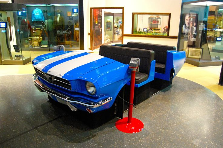 The 50 Capitals Project: Oklahoma City, Oklahoma - Oklahoma History Center - A car was positioned in the middle of the whole room set up like it was a drive-in movie, with a large screen playing clips of Oklahoma movies and speakers standing by the front of the car.