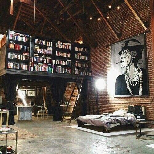 Urban industrial loft:  Bookshelves, brick wall