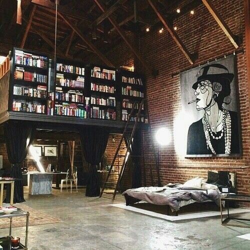 Urban industrial loft:  Bookshelves, brick wall