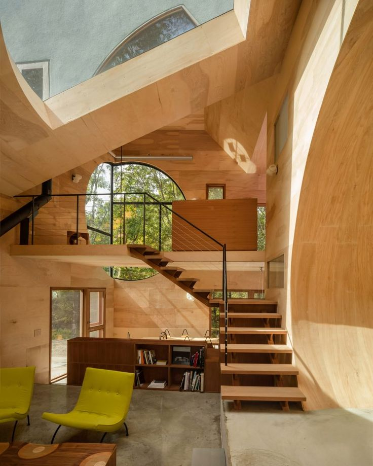 Steven Holl Architects designed this house with three-dimensional shapes cut out from areas.