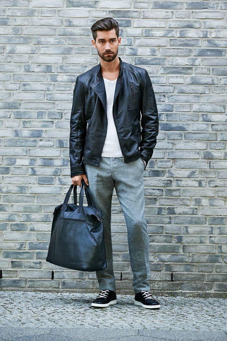 Shop this look on Lookastic:  http://lookastic.com/men/looks/biker-jacket-v-neck-sweater-dress-pants-tote-bag-low-top-sneakers/9426  — Black Leather Biker Jacket  — White V-neck Sweater  — Grey Dress Pants  — Black Leather Tote Bag  — Black and White Leather Low Top Sneakers