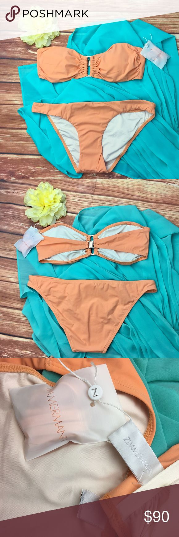 """Zimmermann Sherbet Orange Bandeau Bikini Set Size: Women's 10/12 (Zimmermann brand sizing is #3 = bust 38.9"""", waist 31"""", hips 41.7"""")  Brand: Zimmermann  Condition: New, never worn. Bikini liner intact, never removed.    Peach / Sherbet orange, bandeau bikini top with silver metal details. Lightly padded with removable pads. Straps included.  Tags on bikini bottoms were cut to prevent store returns. Does not affect appearance of bikini.    Fabric: shell 80% Polyester, 20% Elastane; lining 90%…"""