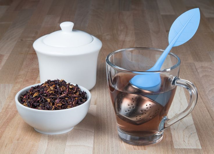 Blue tea infuser in a cup