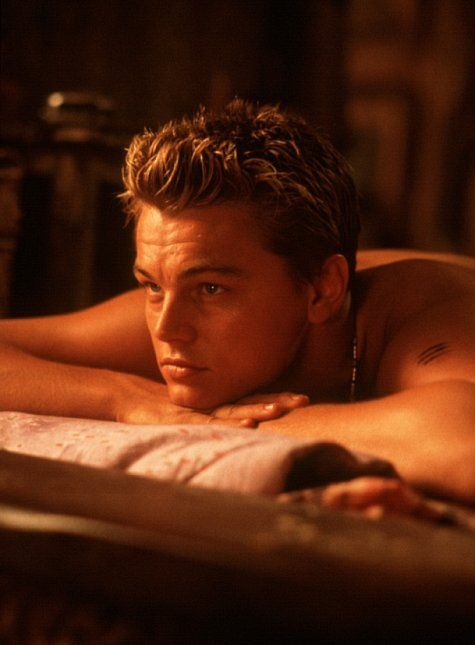 Still of Leonardo DiCaprio in The Beach or on the beach with him, rubbing sun tan lotion on my back with my swimsuit still on! :)