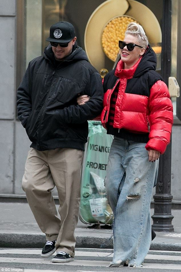 Eccentric:Pink, 38, was dressed in her quintessentially quirky attire as she rocked a pair of extreme wide leg jeans while strolling along the opulent fashion district Rue du Faubourg Saint Honore in Paris with her husband Carey Hart on Wednesday