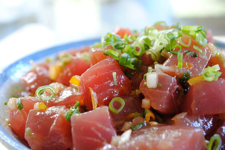 Here's how you can make the basic poke mixture of cubed raw ahi (tuna), salty seaweed, and crunchy sweet onions with Hawaiian-style spices.