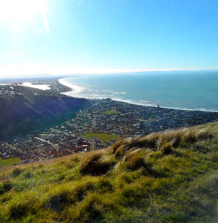 Woodend Beach in the distance. Overview of Christchurch and its coast. Sumner in the foreground, stretching to New Brighton and eventually Woodend Beach.