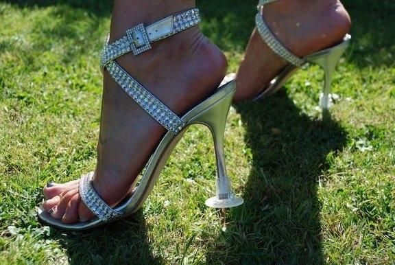 Heel Stoppers. The aisle and where you stand during the ceremony at Ostertag are both paved. However pictures will be in the grass so if you opt for heels instead of wedges/flats/sandals these might help!
