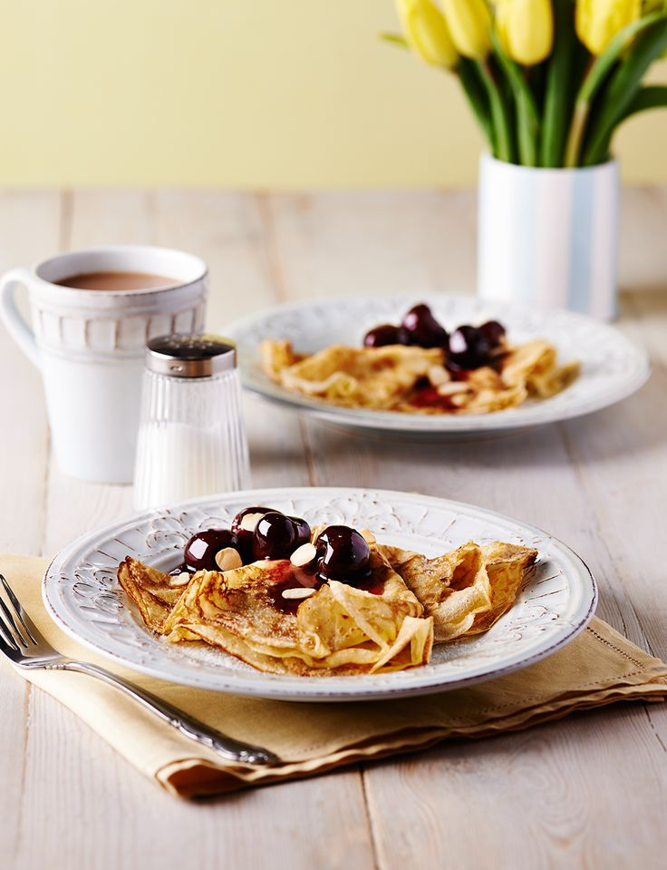 Cherry bakewell meets pancakes for a delicious Pancake Day pud. Classic pancakes are topped with a juicy cherry compote and flaked almonds for crunch.
