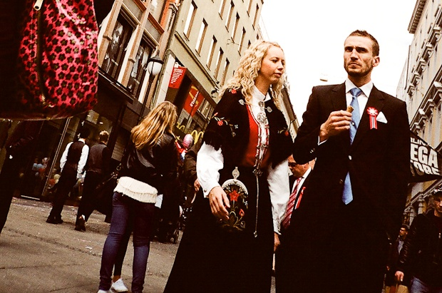 Why Norway National Day Will Make Your Country Look Terrible. Police in Hot Pants,  Nordic Men in Tailored Suits, and Women in Milk-Maid costumes. Welcome to Oslo, on May the 17th, every year.