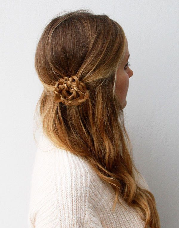 This flower braid is the perfect accessory for a head full of curls. And it's deceptively easy to re-create. Simply grab two sections of your hair to create a ponytail over one ear. Braid a classic three-strand braid, and roll it around its base. Secure it with some bobby pins, and that's it—it's that easy! Follow the step-by-step tutorial here.