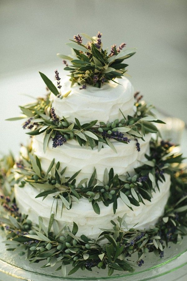 A simple cake adorned with lavender and olive branches