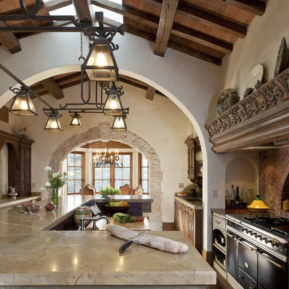 7. Arches. In this generously sized kitchen, an arch separates the cooking and dining areas and adds to the Mediterranean look. There's another arch in the niche by the range