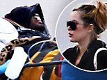 Khloe Kardashian walks beside Lamar Odom as he is transferred to LA hospital | Daily Mail Online