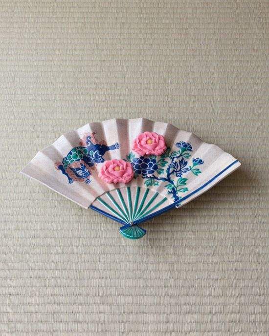 Japanese sweets on a paper fan shaped porcelain tray from Edo period (1603-1868)