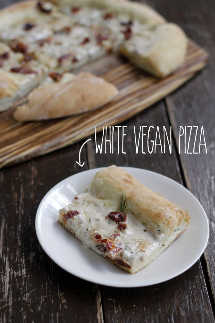 White Vegan Pizza with Sundried Tomatoes and Rosemary.  Sauce made from garlic, coconut milk and salt - that's it!
