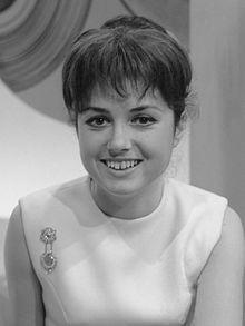 "Gigliola Cinquetti, Italian winner in 1964, singing ""Non ho l'età"" http://www.youtube.com/watch?v=Utd9cHBPfRA"