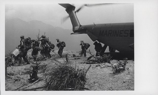 """Marines Disembark, Hill 502, 1969  """"A Temporary Home: Leathernecks of the 7th Marine Regiment disembark from a Marine helicopter atop Hill 502, west-southwest of here, during Operation Oklahoma Hills, a multi-battalion operation directed at North Vietnamese Army units in and around Happy Valley."""""""