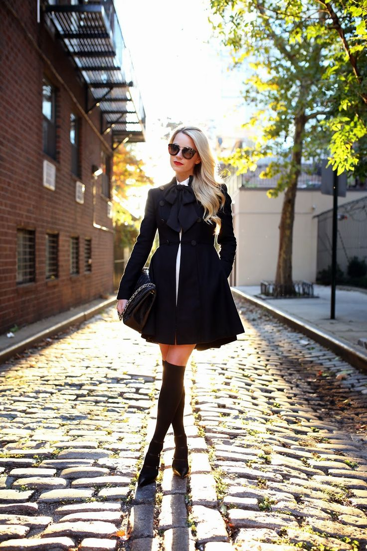 Black pea coat, white dress, over-sized bow tie, over the knee socks, heels and an over-sized clutch   Atlantic-Pacific: tied up
