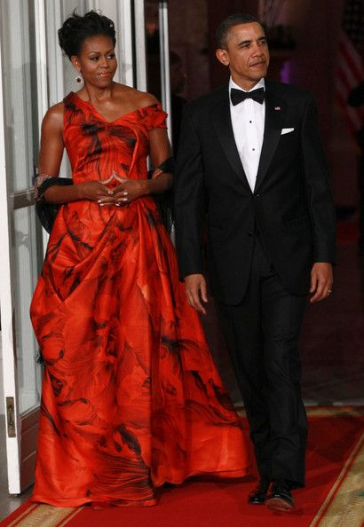 Michelle Obama Evening Dress     Michelle donned one of her most phenominal looks to date in a fiery off-the-shoulder gown with a smoky floral print.   Brand: Alexander McQueen