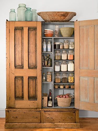 To convert this armoire into a kitchen pantry, the homeowner added extra shelves and magnetic door closures.