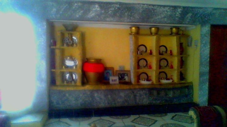 I designed this cement display unit  with yellow interiors on the opposite wall of the grey and white gel fireplace in the livingroom. For my african deco, I displayed with black and white plates,  gold and white tea set and other deco items. I placed a big garden gold cement pot striped red in the center of my grey and white unit with gold stripes.