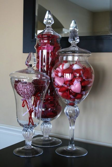 Simple apothecary jars look great on a mantle with the addition of seasonally appropriate candies.