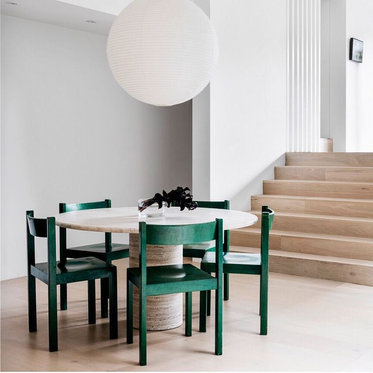 "402 Likes, 11 Comments - Real Living Magazine (@reallivingmag) on Instagram: ""Travertine table, green wooden chairs and a round paper pendant  This is the dining room dreams…"""
