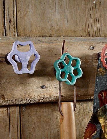 Cute for a garden shed!  Reuse old faucet handles as hooks