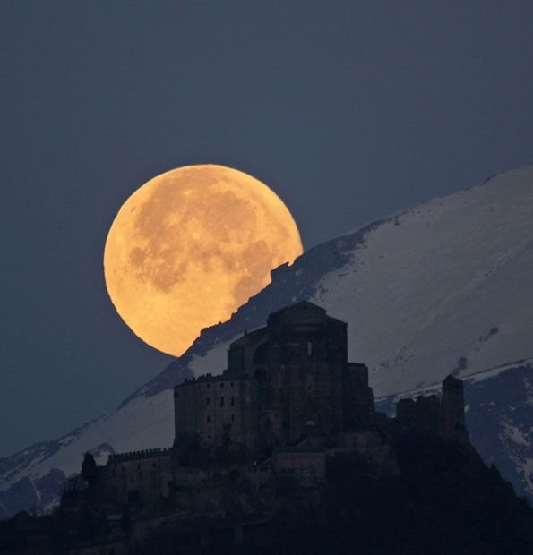 Full moon setting behind the Alps by Stefano De Rosa