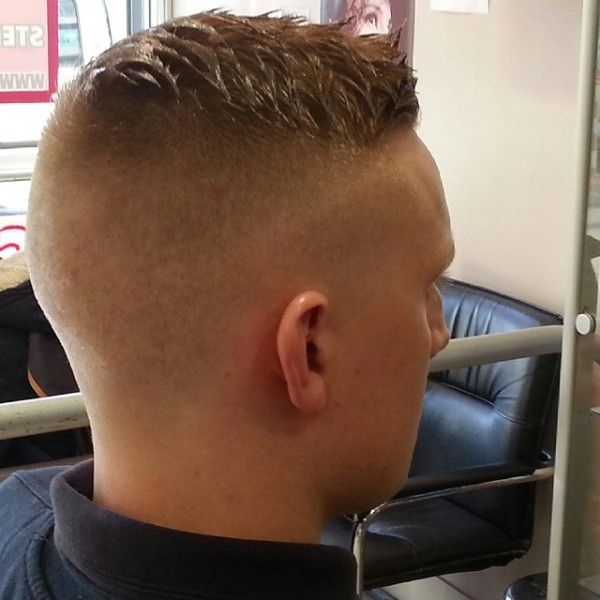 High and tight. Although the top is styled a bit weird it is still an awesome haircut!