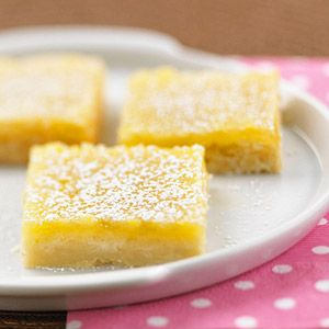 Sweet and tart, these moist, powdered-sugar-topped dessert bars will disappear fast.