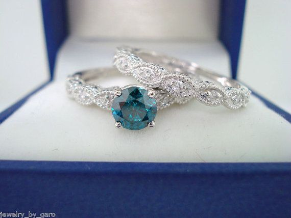 Blue & White Diamond Engagement  Ring Wedding by JewelryByGaro. I love the hand crafted detailing and that it's not diamond detailing. I love this ring it just needs a larger Blue princess cut diamond.