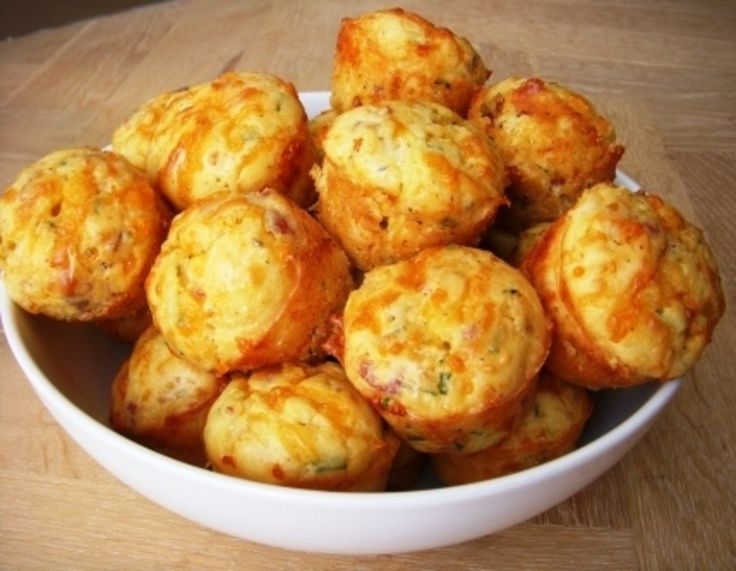 These quiches whip up in no time and are a fun finger food to feed a crowd. Loaded with eggs, bacon, and cheese–they are sure to please! I made these for my son's first Birthday party brunch and was repeatedly asked for the recipe. So here it is!