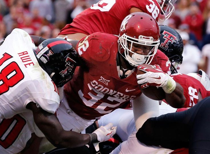 Oklahoma's Samaje Perine (32) scores during a college football game between the University of Oklahoma Sooners (OU) and the Texas Tech Red Raiders at Gaylord Family-Oklahoma Memorial Stadium in Norman, Okla., on Saturday, Oct. 24, 2015. Photo by Steve Sisney, The Oklahoman