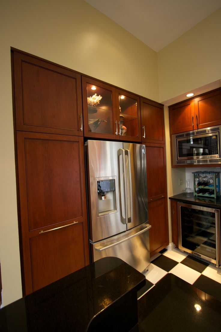 Wooden Refrigerator Cabinets ~ This transitional kitchen is where retro and rustic meet