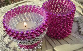 Beads on glass voltive holders - you can use the strands of mardi gra beads from $ store