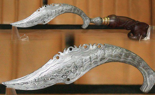 One of the most fascinating daggers of Java is the kujang, a sickle-shaped dagger believed to uphold the balance of the world. Once popular with Javanese kings, the kujang's distinctly shaped blade was believed to have been inspired by a divine message proclaiming their sovereignty.,,,,mmmm-kay