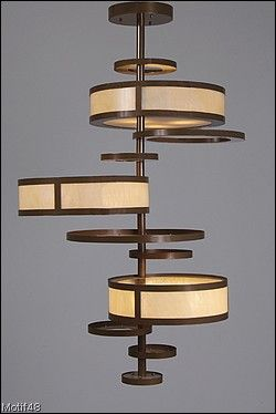 A stunning chandelier inspired by the mobiles of George Nelson ~ a mid century designer.