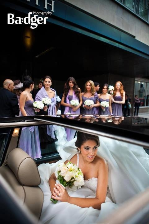 Bride leaving in limo from Fairmont Queen Elizabeth Hotel - Montreal Wedding by Badger Photography http://badgerphotography.ca