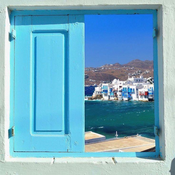 Mykonos island (Μύκονος)! The lovely Little Venice through a Cycladic window , looks like a beautiful painting .