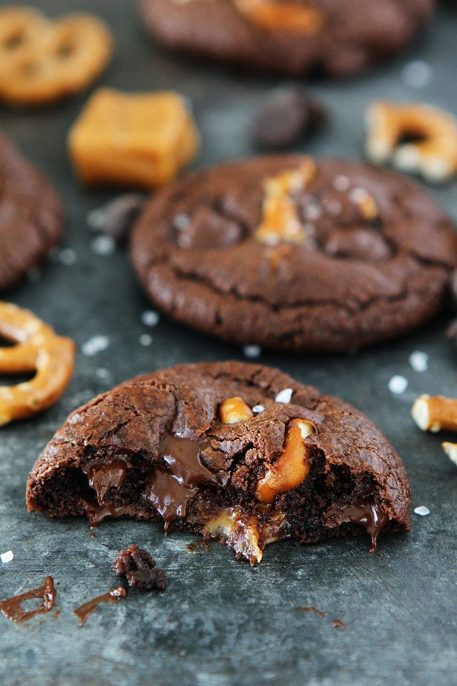 Chocolate Salted Caramel Pretzel Cookies Recipe on twopeasandtheirpod.com Chocolate cookies with a gooey caramel center, pretzel pieces, and a sprinkling of sea salt. Everyone loves these sweet and salty cookies!