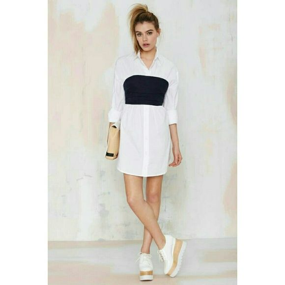Maurie & Eve Lorenza Dress Business class? More like business sass. The Lorenza Dress from Maurie & Eve is a white poplin shirt dress and features navy bandeau layer with pleating, functional front button closure, gathering detail, and sculpted hemline. Side zip closure, unlined. Perfect with platforms and a crossbody. *Cotton/Polyester  *Runs true to size? *Model is wearing size small? *Hand wash cold? *Imported Maurie&eve Dresses