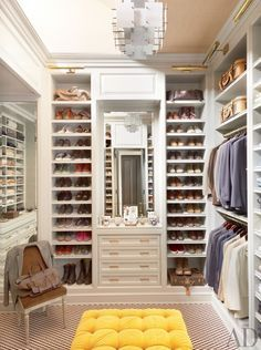 master bedroom closet...shoe storage, drawers and bench!